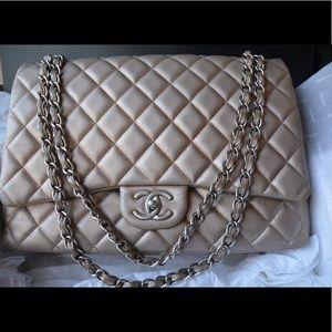 CHANEL Maxi bronze double flap bag